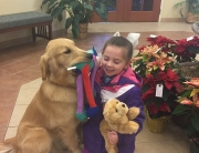 """Our Amazon Wish List includes the stuffed animal you see here. When children meet our therapy pet, Joy, she reassures them at a difficult time. When we give them their own """"Joy"""" to keep, it's a constant reminder of that reassurance."""