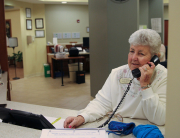 Jelemia Sanders, a 20-plus year volunteer at Hospice Care Plus, answers phones at the Compassionate Care Center.